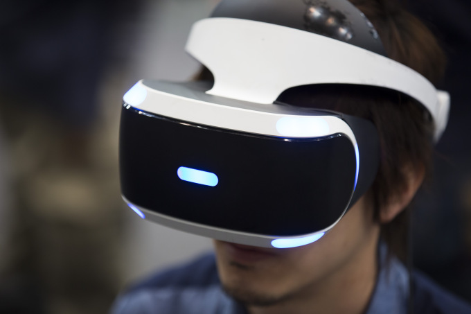 A visitor wears a Sony Computer Entertainment Inc. PlayStation VR as he tries a virtual reality (VR) game during a demonstration by Tokyo VR Startups in Tokyo, Japan, on Tuesday, June 29, 2016. Tokyo VR Startups has launched the first Japanese incubation program focused on the virtual reality market, says the company website. Photographer: Tomohiro Ohsumi/Bloomberg via Getty Images