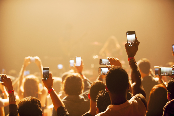 Fans using smartphones at a concert