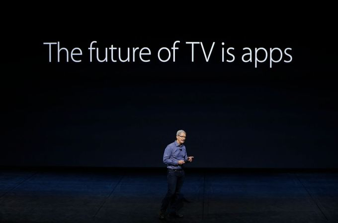 "Tim Cook at Apple event standing in front of big sign: ""The Future of TV is apps."""